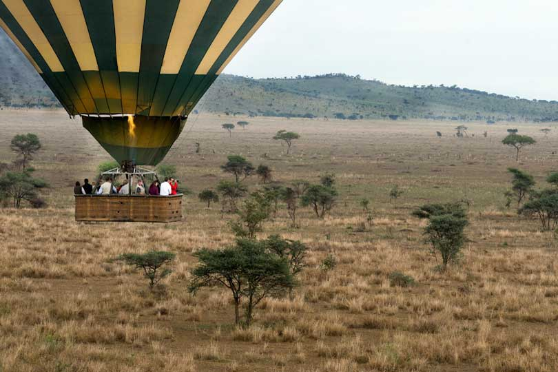 Clients flying in a hot air balloon over Serengeti National Park, Tanzania